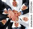 Business people hands on top of each other showing unity - stock photo