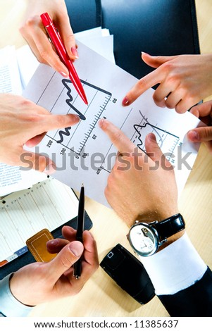 Business people' hands showing the document