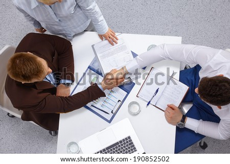 Business people handshake - stock photo