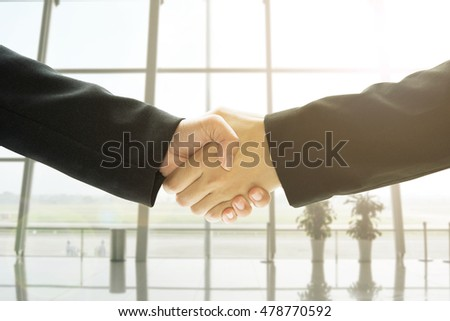 Business people handshake in office background, concept business cooperation