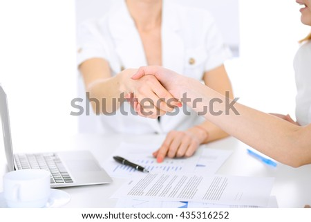 Business people handshaking after contract signing - stock photo