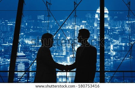 Business people handshaking in the city. - stock photo