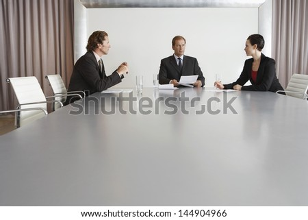 Business people having a discussion in conference room - stock photo