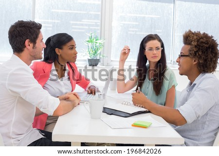 Business people having a meeting together in the office - stock photo