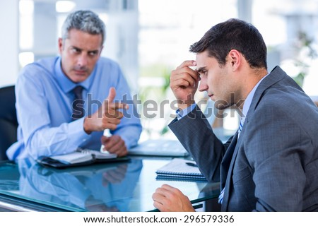 Business people having an argument in office - stock photo