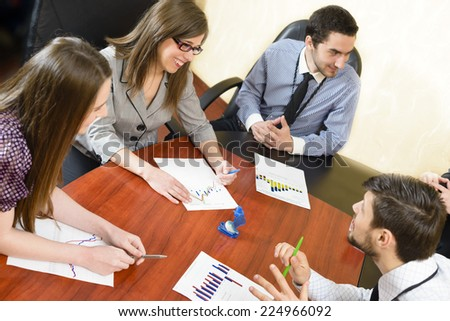 Business people having board meeting at office - stock photo