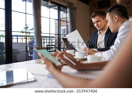 Business people having coffee and working with documents