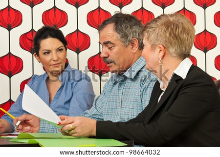 Business people having conversation at meeting in modern office - stock photo