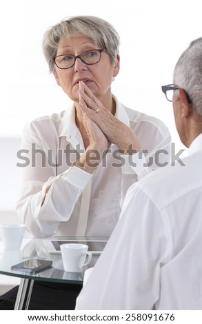 Business people having discussion at coffee table. - stock photo