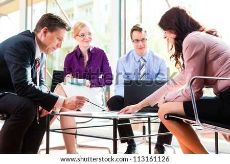 Business people having meeting or workshop in office - stock photo