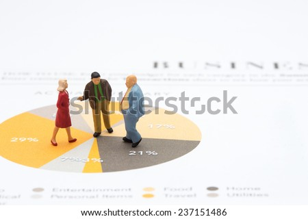 business people having meeting standing on graph - stock photo