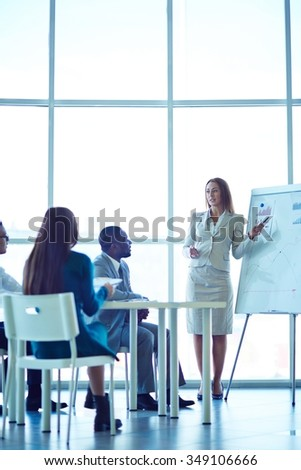 Business people having on presentation at office - stock photo