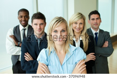 Business people headed by a woman in an office - stock photo