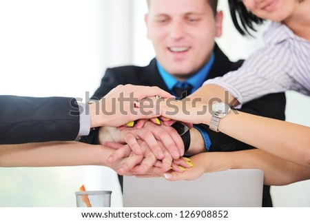 Business people hold their hands together, teamwork and togetherness concept - stock photo
