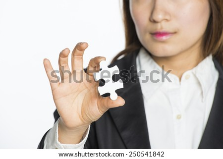 Business people Holding Jigsaw Puzzle - stock photo