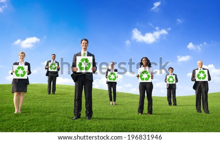 Business People Holding Placard with Recycling Symbol