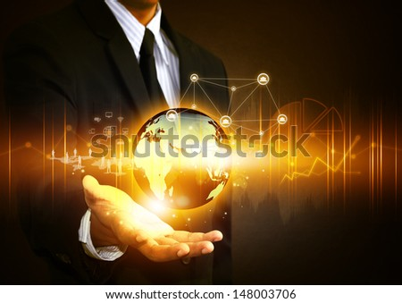 Business people holding social network with globe - stock photo