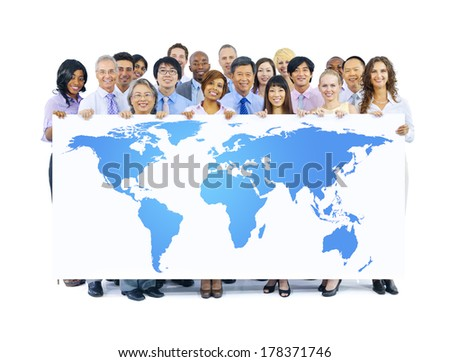 Business People Holding the World Map - stock photo