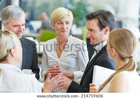 Business people in a circle discussing in a meeting - stock photo