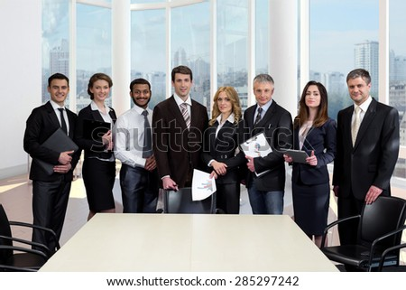 Business people in a large modern glass office. Successful managers. Office with panoramic windows. - stock photo