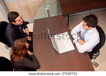 Business people in a meeting at an office - stock photo