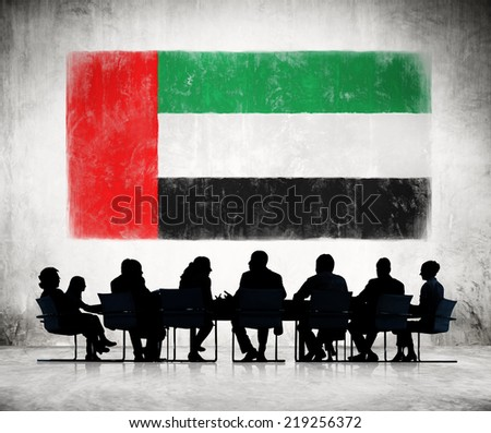 Business People in a Meeting with United Arab Emirates Flag - stock photo