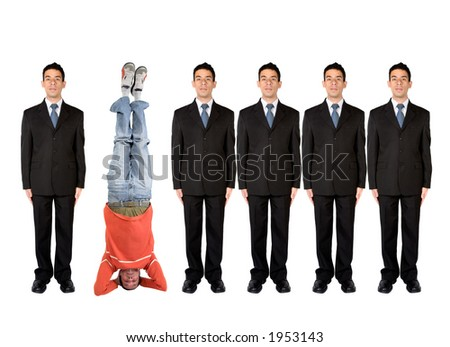 business people in a series with a casual guy doing the headstand - stock photo