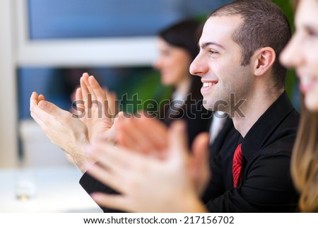 Business people in a successful meeting - stock photo