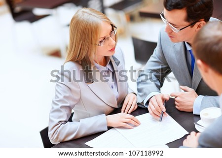 Business people in a suit at the office - stock photo