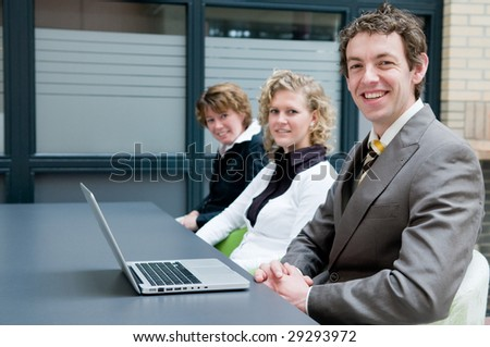 Business people in an office, during a meeting. - stock photo