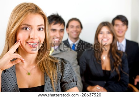 business people in an office smiling - small team