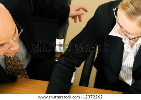 Business people in discussion (focus only on eyes) - stock photo