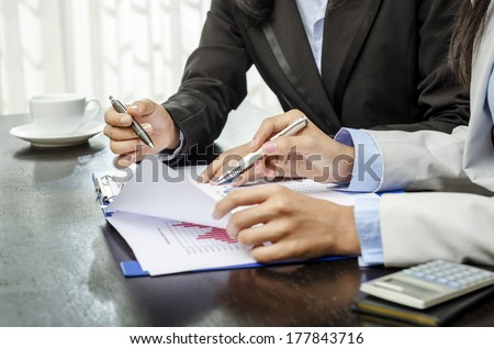Business people in meeting in office - stock photo