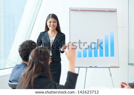 Business people in presentation - stock photo