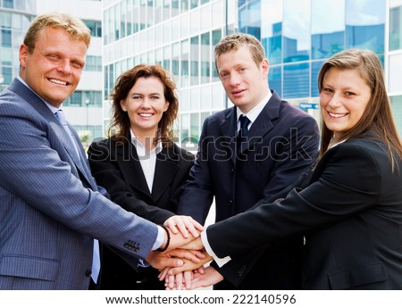 Business people joining hands - stock photo