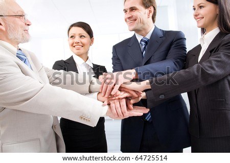 Business people joining their hands - stock photo