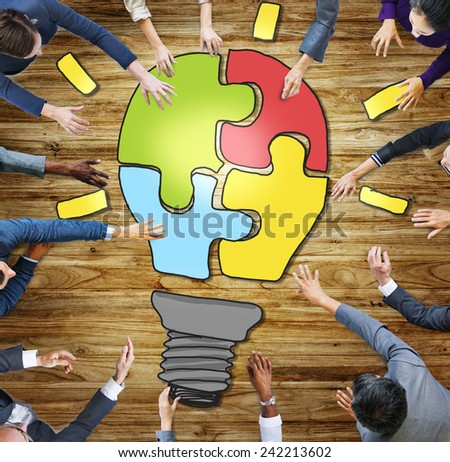 Business People Light Bulb Innovation Jigsaw Togetherness Concepts - stock photo