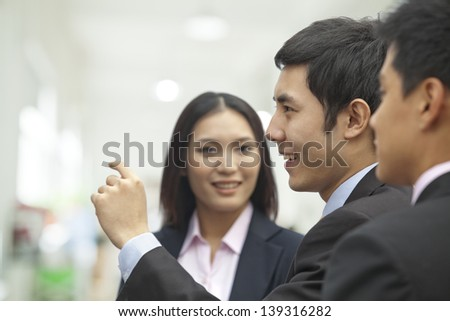 Business People Looking at Wall - stock photo