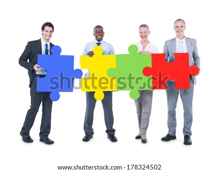 Business People Making a Jigsaw Puzzle Connection - stock photo
