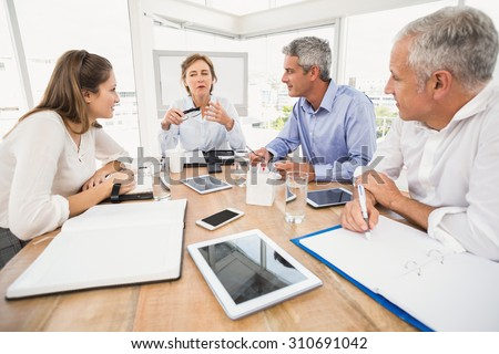 Business people making arrangements in the office - stock photo