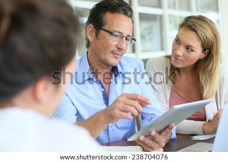Business people meeting and using digital tablet - stock photo