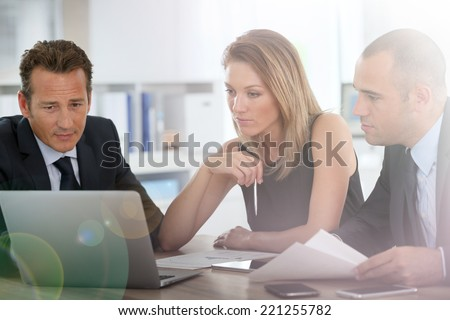 Business people meeting around table - stock photo