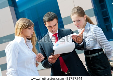 Business people meeting in a modern downtown.