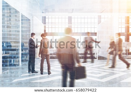 Business People Near Office Cubicles In An With White And Wooden Walls There Are