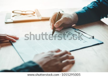 Business People Negotiating Contract Between Two Stock Photo
