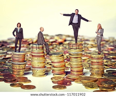business people on euro coin piles - stock photo