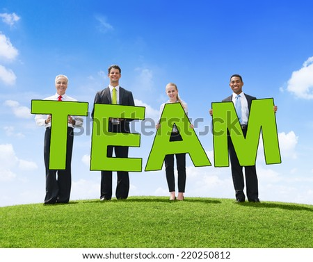 Business People Outdoors Holding Text Team - stock photo
