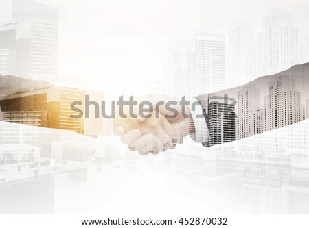 business, people, partnership, gesture and cooperation concept - businessman and businesswoman shaking hands over city with double exposure effect background - stock photo