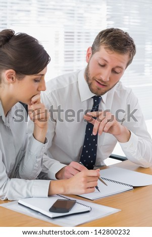 Business people planning together at desk in office - stock photo