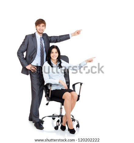 Business people point finger to side empty copy space, businesswoman sitting in chair businessman happy smile, Isolated over white background - stock photo